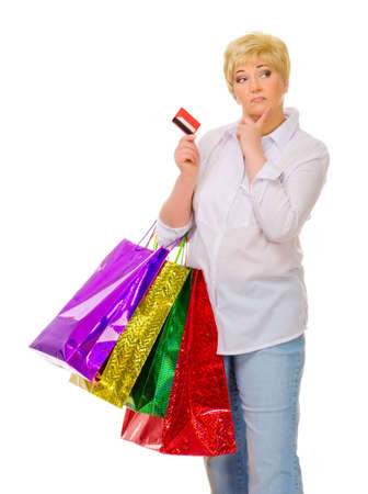 Senior woman with bags and credit card isolated photo