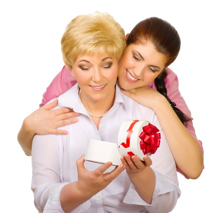 Senior woman with gift isolated
