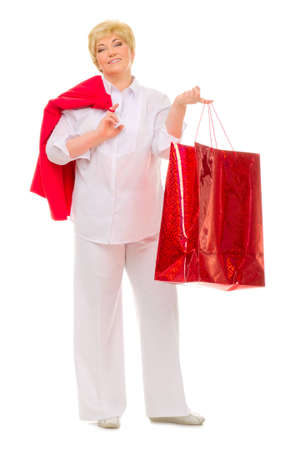 Happy senior woman with bag isolated photo