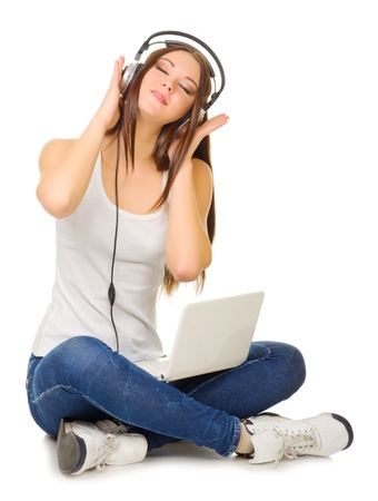 listen to music: Young girl listen music isolated Stock Photo