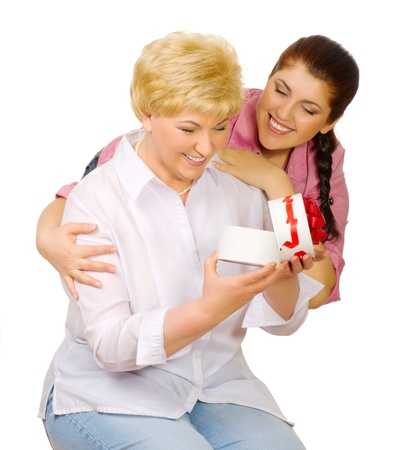 relationship mother and daughter: Young woman give gift to her mother isolated