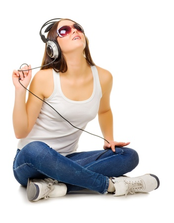 Young woman listen music isolated Stock Photo - 12989973