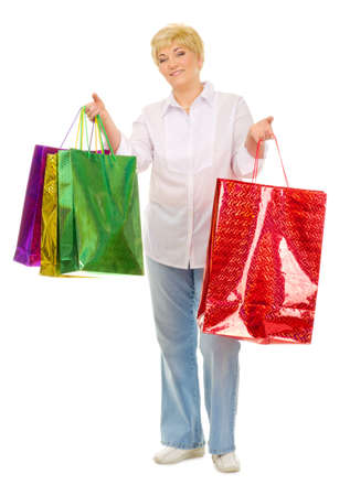 Happy senior woman with bags isolated photo