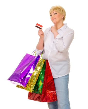 Senior woman with credit card and bags isolated photo
