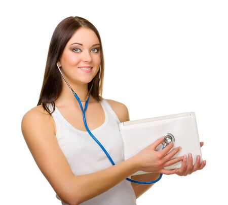 Young woman listen laptop by stethoscope isolated photo