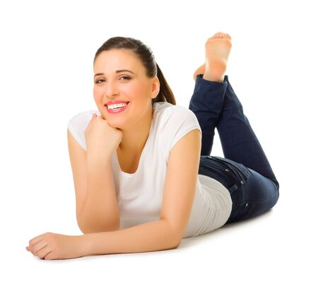 Young woman laying on the floor isolated Stock Photo - 13533449