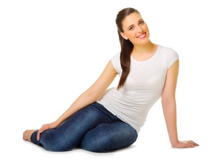 untroubled: Young woman sitting on the floor isolated