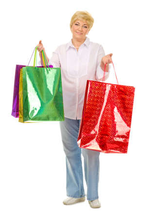 Senior woman with bags isolated photo