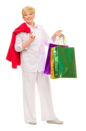 Senior woman with bags isolated Stock Photo - 13533466