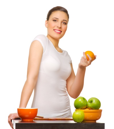 Young smiling girl with fruits isolated photo