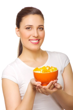 Young girl with fruit salad isolated photo