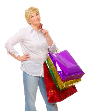 Senior woman with bags and credit card isolated Stock Photo - 13609463