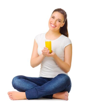 Young girl with orange juice isolated photo