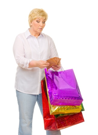 Senior woman with wallet and bags isolated photo