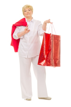 Senior woman with bag isolated photo