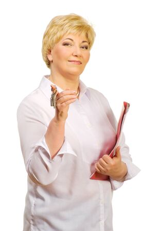 Senior woman with keys and folder isolated photo