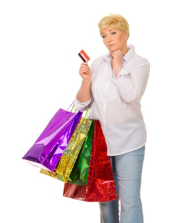 Senior woman with bags and credit card isolated Stock Photo - 14360593