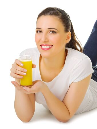 Smiling young girl with orange juice isolated photo