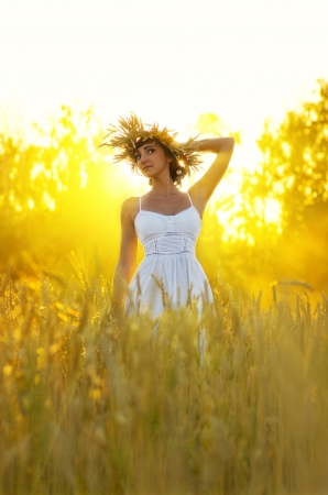 rays sun: Young woman on wheat field Stock Photo