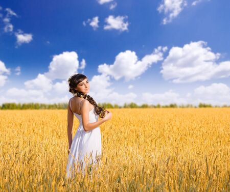 Young woman on wheat field photo