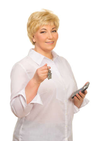Senior woman with keys and calculator isolated photo