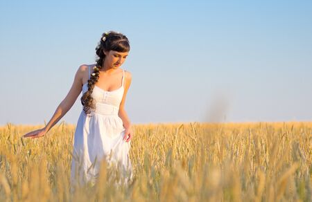 Young girl on wheat field photo