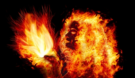 Burning girl holds a flame in palms
