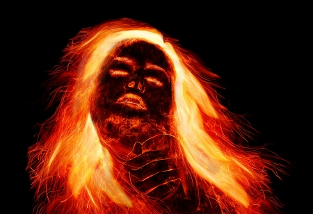 Burning girl with fiery hair Stock Photo