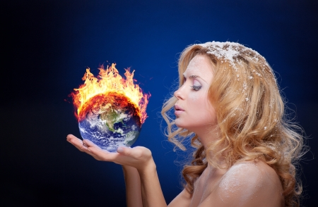 fire damage: Frozen girl holding burning earth globe (west hemisphere) in palms (elements furnished by NASA) - version without glowing
