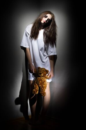 angry teddy: Zombie girl with plush teddy bear