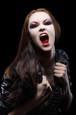 Young beautiful vampire woman isolated photo