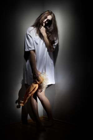 Zombie girl with plastic doll Stock Photo - 15690681