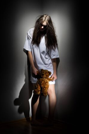 angry teddy: Young zombie girl with teddy bear