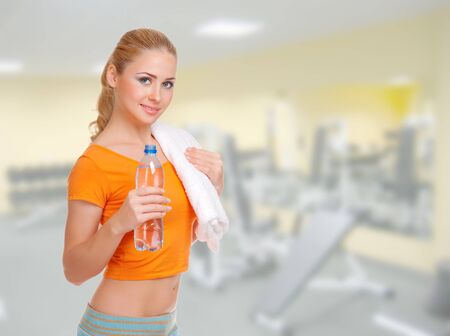 Young sporty smiling woman on health club photo