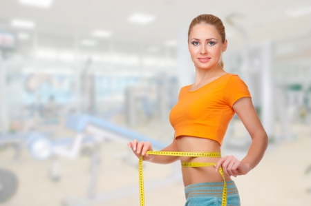 Young sporty smiling woman on health club Imagens