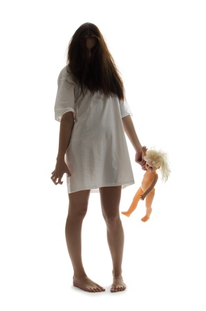 Zombie girl with doll isolated photo
