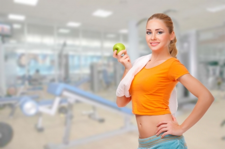 Young sporty woman at fitness club photo