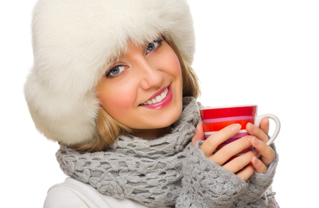 Young smiling girl with red mug isolated photo