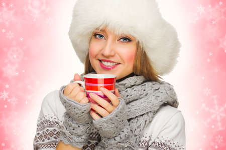 Young smiling girl with sweater and mug photo