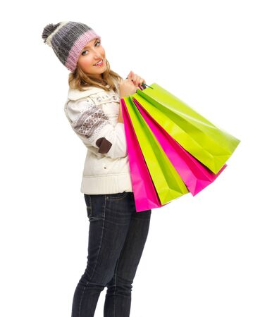 Young woman with bags isolated photo