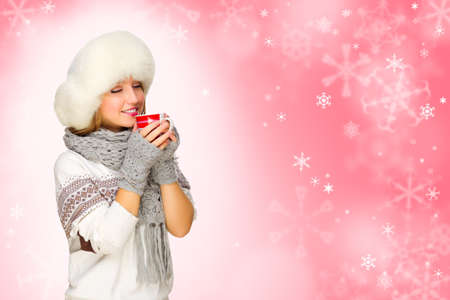 Young girl with mug on red snowy background photo