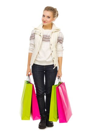 Young smiling girl with bags isolated Stock Photo - 16963979