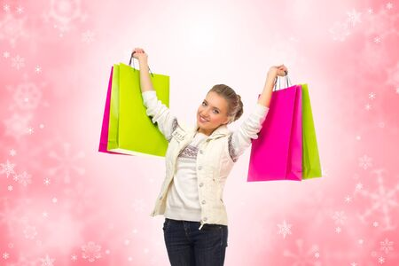 Young smiling girl with bags on winter background Stock Photo - 16963990