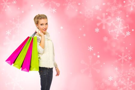Young girl with bags on red winter background Stock Photo - 17056534