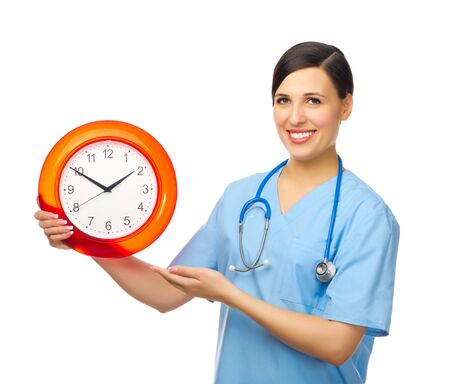 Young doctor with clock isolated Stock Photo - 17505243