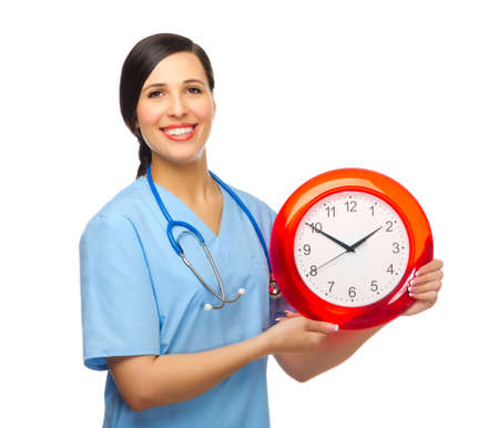 Young doctor with clock isolated Stock Photo - 17786621