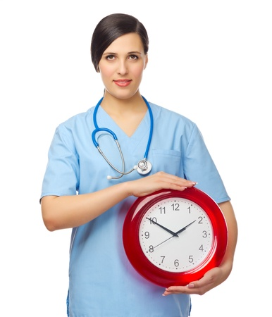 Young doctor with clock isolated Stock Photo - 18034805