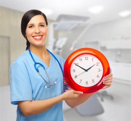 Doctor with clock at medical office Stock Photo - 18314966