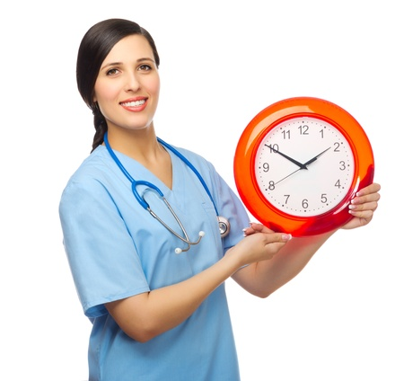 Doctor with clock isolated on white Stock Photo - 18466117