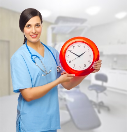 Doctor with clock at medical office Stock Photo - 18602367